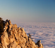 Evening rocks and sea in clouds Stock Image
