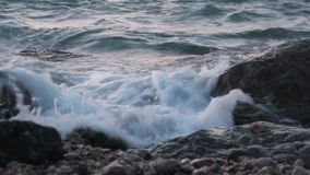 Evening rocky beach on a cloudy day stock video footage