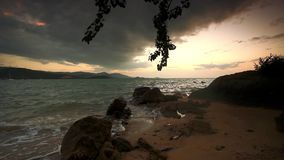 Evening rocky beach on a cloudy day. Thailand. Beautiful tropical beach. Thailand Koh Samui stock video