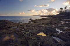 Evening at rocky coast of Lanzarote Royalty Free Stock Images