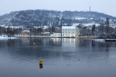 Evening romantic snowy Prague Lesser Town above River Vltava with Hill Petrin Royalty Free Stock Images