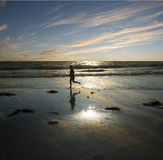 Evening runner. Solitary  man running along the waters edge in the evening Stock Images