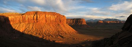 Evening sandstone cliffs. Panorama of sandstone cliffs in Indian Creek, Utah lit by orange evening light Royalty Free Stock Photography