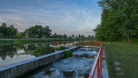 Evening scene on a bank of a river stock footage