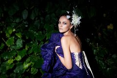 Evening scene - beauty fashion girl sitting Stock Photography