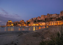 Evening scene in an harbour in Sicily royalty free stock photography