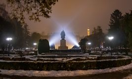 Satu Mare of Romania, historical statue at night. Evening scene outdoor in the main garden of Satu Mare with mysterious lights over Vasile Lucaciu statue, in stock images