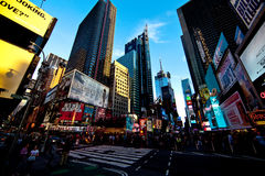Evening scene of Times Square in Manhattan. In New York City with all the lit up billboards and advertisements Stock Photos