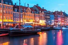 Evening scenery of Nyhavn in Copenhagen, Denmark. Scenic evening panorama of Nyhavn pier architecture in the Old Town of Copenhagen, Denmark Stock Images