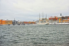 Evening scenery of the Old City of Stockholm with a ship in Swed Royalty Free Stock Photography