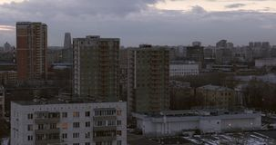 Russian urban scenery. Evening scenery of some Moscow district. Lots of apartment buildings of different colors, number of storeys and architectural styles. Bare stock video