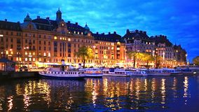 Evening scenery of Stockholm, Sweden. Scenic summer evening panorama of the Old Town Gamla Stan architecture pier in Stockholm, Sweden stock footage