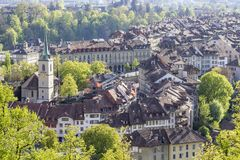 Evening scenic of The city of Bern, the capital of Switzerland. Bern is built on very uneven ground. The Aare river flows in a wide loop around the Old City of Royalty Free Stock Photos