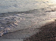 Evening sea beach with shingle in summer at sunset Royalty Free Stock Photo