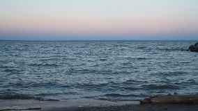 Evening sea, horizon. The sunset, the ocean or a large lake stock video