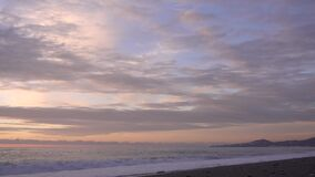 Evening. Sea. The sky is painted in pastel shades