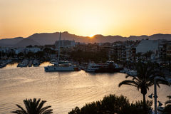 Evening sea views of the harbor, resort city and mountains Royalty Free Stock Photo