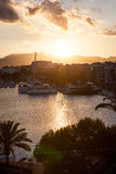 Evening sea views of the harbor, resort city and mountains. Evening sea views of Alcudia city of Majorca Island Royalty Free Stock Photo