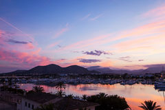 Evening sea views of the harbor, resort city and mountains. Evening sea views of Port Alcudia of Majorca Island Stock Image
