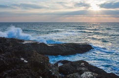 Evening seascape view from rocky shore. Royalty Free Stock Image