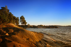 Evening seaside. Autumn evening northern sea coast Stock Image