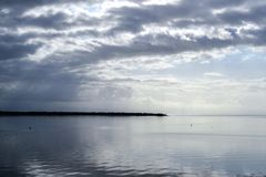 Evening at the seaside. Dark clouds above the water.  royalty free stock photos