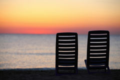 In evening at seaside two chairs cost Stock Photo