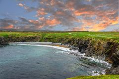 An evening at a secluded beach in Newfoundland, Canada. Beautiful scenery from Newfoundland landscape, Canada. Rugged ocean scenery and a beautiful marriage of stock photography
