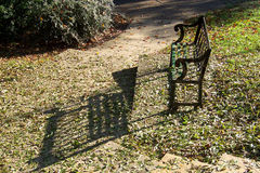 Evening Shadows From Old Park Bench Royalty Free Stock Images