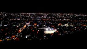 Evening shot of sapporro city from the top of mountain moiwa, hokkaido, japan. N stock footage