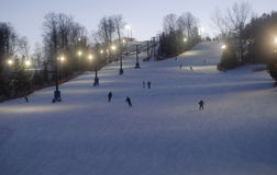 Evening skiing. Night time skiing and snowboarding at a small ski hill in south western Ontario Royalty Free Stock Photos