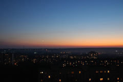Evening sky. With moon and starrs above the city Royalty Free Stock Photos