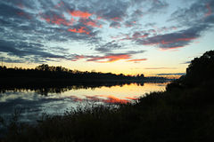 Evening sky. Reflection of the evening sky in the river Royalty Free Stock Images