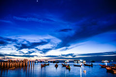 Evening Sky and Boats. Fisherman Boats in the ocean during purple evening sky Stock Photos