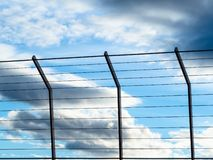 Evening sky with clouds behind gratings royalty free stock image