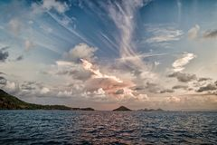 Evening sky with clouds in blue sea in gustavia, st.barts. Wild nature, environment and ecology. Holiday destination. While travelling. Summer vacation and stock image