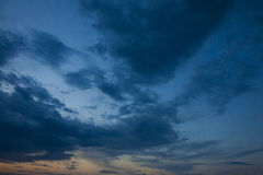 Evening sky with clouds. Evening sky with dark blue clouds at sunset Stock Images