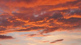 Evening sky with dramatic sunset clouds. Over the city house stock video footage