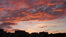 Evening sky with dramatic sunset clouds. Over the city house stock footage