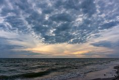 The evening sky has clouds full of sky, the light from the sun reflect Seawater, sea surface.  royalty free stock images