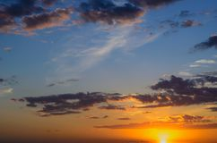 The evening sky is illuminated by the sun at sunset royalty free stock photos
