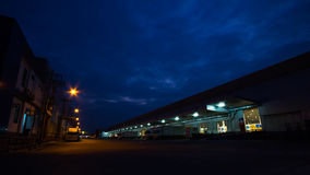 Evening sky and light warehouse area Royalty Free Stock Images
