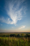 Evening sky over the field. Stock Image