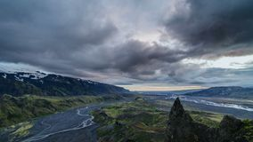 Evening sky over Iceland mountains landscape. Time lapse. Colorful evening with gray clouds moving over sky in Iceland volcanic mountains and river landscape in stock video footage