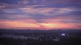 The evening sky over the metropolis. The evening red sky over the metropolis stock footage