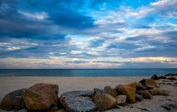 Evening sky over sea shore stock image