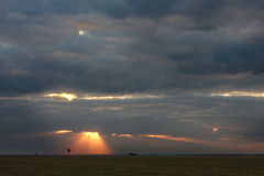 Evening sky over vast meadows. Evening sky with warm rays of setting sun over vast meadows in early spring Stock Images