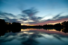 The evening sky reflecting in the water Royalty Free Stock Photography