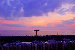 Evening sky,rows of bamboo sticks in the sea and cement bridge near Matchanu Shrine,Phanthai Norasing,Mueang Samut Sakhon District royalty free stock photos