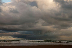 Evening sky scape with storm at sea. Evening sky at Pouawa, New Zealand, with storm at sea and rain squall brewing Stock Photography